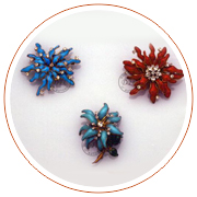 Three flower brooches, 